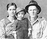 Elvis Presley with his parents Vernon and Gladys Presley