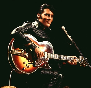 Some of Presley's outfits, including this black leather suit and