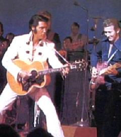 James Burton (guitarist) on stage with Elvis